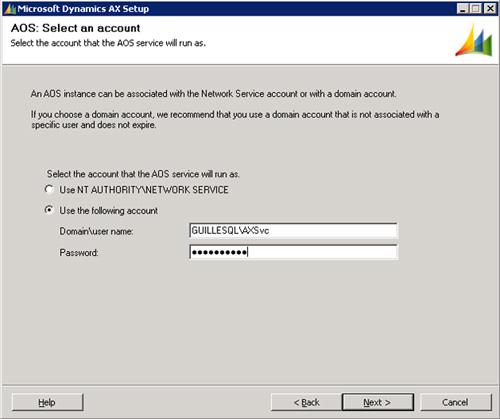Especificaremos las credenciales de la cuenta que deseamos utilizar para iniciar el servicio de AOS, en nuestro caso de ejemplo una cuenta de Directorio Activo (GUILLESQL\AXSvc). Click Next para continuar.